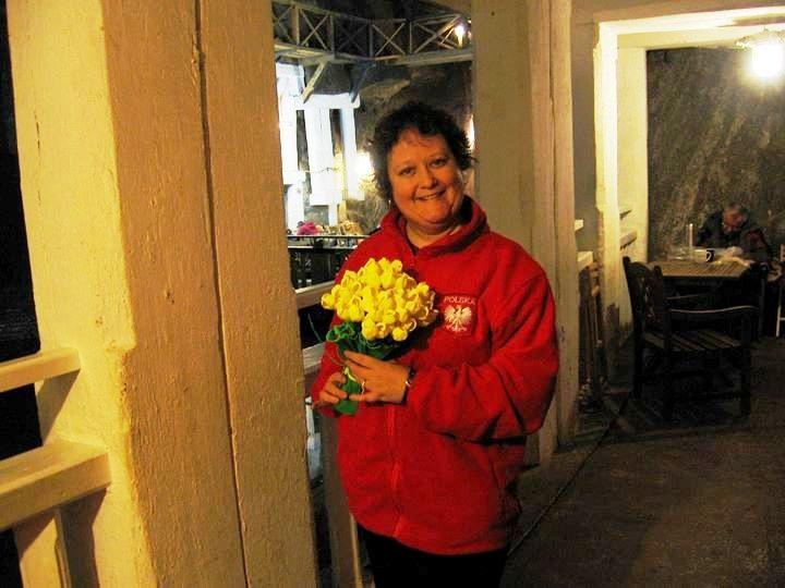 Bimini with a bouquet of paper flowers, a goodbye gift from her Polish friends