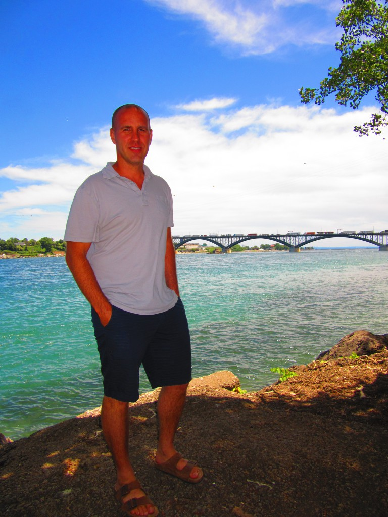 Jason Pizzicarola in front of the Peace Bridge in Fort Erie